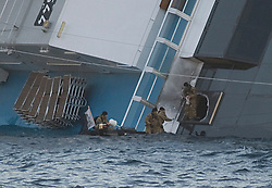 "Military Divers blow holes into The Wrecked Cruise Ship ""Costa Concordia"" in Giglio, Italy, Photo By Nick Cornish/ I-Images."