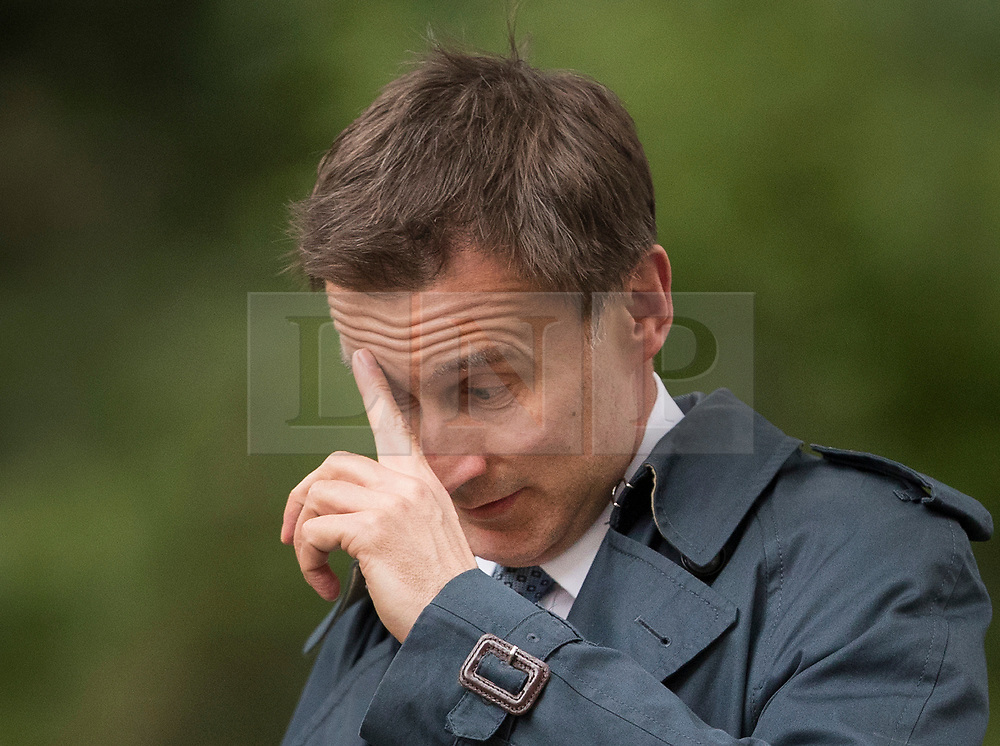 © Licensed to London News Pictures. 15/05/2017. London, UK. Health Secretary Jeremy Hunt arrives in Downing Street in Westminster, London ahead of a COBRA meeting. Members of British government are meeting to discuss the recent cyber attack on over 150 countries, which crippled parts of the NHS.  Photo credit: Peter Macdiarmid/LNP