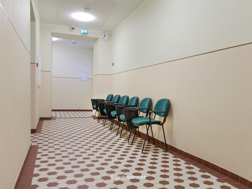 Corridor, seats with checked red and white floors in Tartu University, Estonia inside, interior