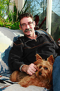 Jerry Woodbury at home in Kettering, joined by his dog Bondi, Saturday, December 22, 2012.