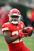 Kansas City Chiefs running back Kareem Hunt (27) runs the ball while warming up before the 2017 NFL week 7 regular season football game against the Oakland Raiders, Thursday, Oct. 19, 2017 in Oakland, Calif. The Raiders won the game 31-30. (©Paul Anthony Spinelli)