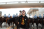 An Occupy Chicago protester confronts mounted police, October 10, 2011.