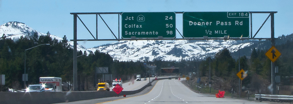 roadsign above I-80 approach to Donner Pass at Truckee, California