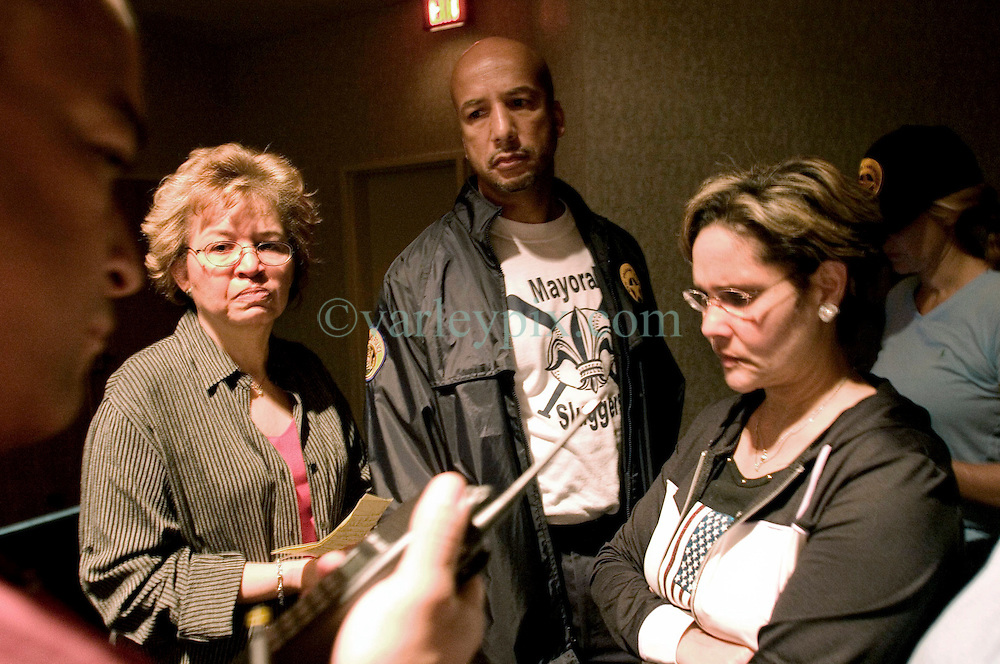 29th August, 2005. Hurricane Katrina hits New Orleans, Louisiana. Mayor Ray Nagin and top city councillors listen to the latest reports coming in on the emergency services radio.<br /> Photo; Charlie Varley/varleypix.com