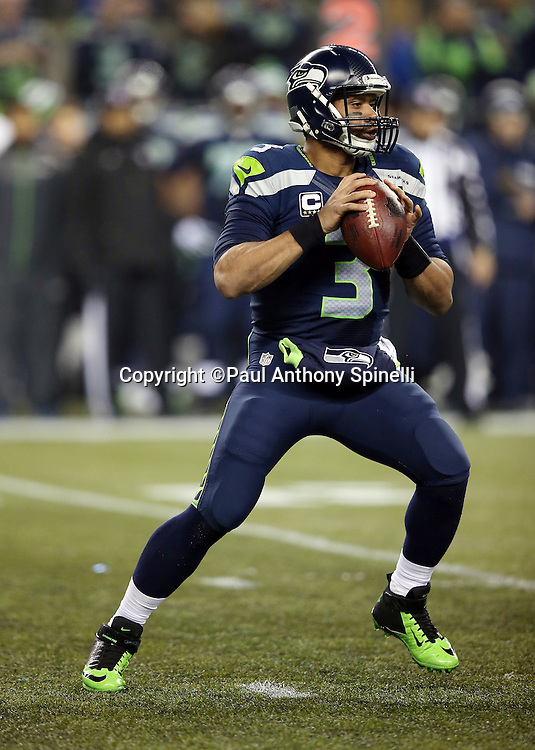 Seattle Seahawks quarterback Russell Wilson (3) throws a second quarter pass for a short gain to the Seahawks 24 yard line during the NFL week 19 NFC Divisional Playoff football game against the Carolina Panthers on Saturday, Jan. 10, 2015 in Seattle. The Seahawks won the game 31-17. ©Paul Anthony Spinelli