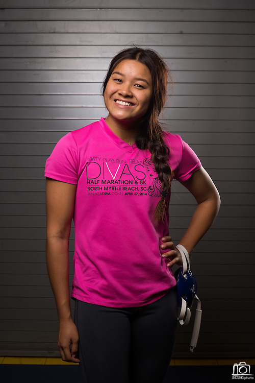 Junior Claire Delacruz poses for a portrait during wrestling practice at Milpitas High School in Milpitas, California, on December 11, 2015. (Stan Olszewski/SOSKIphoto)