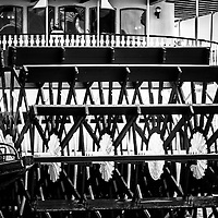 Picture of Natchez Steamboat paddle wheel in New Orleans. The Natchez Steamboat is docked at Toulouse Street and provides cruises on the Mississippi River.