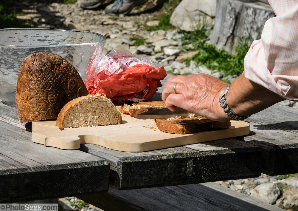 Bread served at Widderalp mountain restaurant, in the Alpstein limestone range, Appenzell Alps, Switzerland, Europe.  Below Bötzel pass, Widderalp comforts hikers with a homey restaurant and dormitory style (Matratzenlager) lodging. Appenzell Innerrhoden is Switzerland's most traditional and smallest-population canton (second smallest by area).