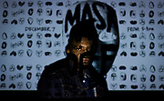 """Artist Faisal Abdu'Allah poses for a portrait during the opening of the """"MASK OFF"""" exhibit inside the Dane County Department of Human Services Neighborhood intervention Program, Thursday, December 7, 2017."""