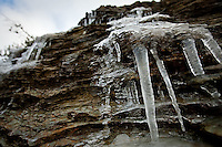 JEROME A. POLLOS/Press..Icicles hang from the rocky hillside Wednesday morning along Coeur d'Alene Lake Drive as the temperatures slowly climbed out of the 20s.