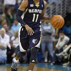 April 1, 2011; New Orleans, LA, USA; Memphis Grizzlies point guard Mike Conley (11) against the New Orleans Hornets during the first quarter at the New Orleans Arena.    Mandatory Credit: Derick E. Hingle