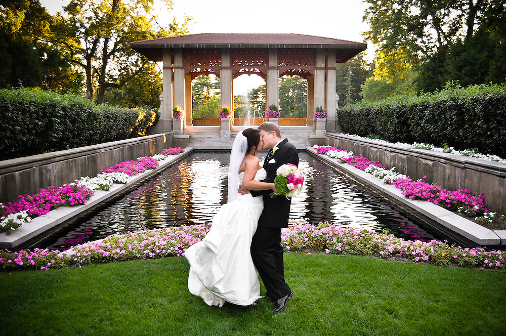Kelly & Craig kiss in front of the fountain at The Armour House, Lake Forest, IL