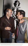 Minimum  Reproduction fee: $150 please check for permission. John Varvatos and Nicky Haslam in front of Helmut Newton photograph at thepreview of the forthcoming auction of photographs. Philips de Pury and Luxembourg. 26 September 2002.  of © Copyright Photograph by Dafydd Jones 66 Stockwell Park Rd. London SW9 0DA Tel 020 7733 0108 www.dafjones.com