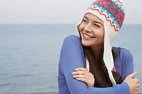 Young woman wearing wool hat on beach portrait