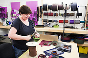 DEXTER, ME - AUGUST 4, 2015:  Sue Nordman, owner of Erda Handbags, works on the prototypes for a new line of mens shaving kits at the company's production facility in Dexter, Maine. Since most of Erda's employees are 60 years or older they have implemented a flexible scheduling system and invested in more ergonomic machines to accommodate their aging workforce. <br /> Craig Dilger for The New York Times