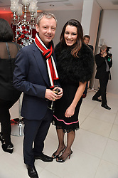 JOHN SIMM and KATE MAGOWAN at a pre party for the English National Ballet's Christmas performance of The Nutcracker was held at the St.Martin's Lane Hotel, St.Martin's Lane, London on 12th December 2013.