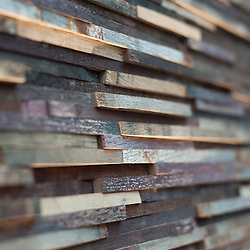 London, UK - 5 February 2014: a surface made of recycled Rioca wine barrels by Panel Stone is on display at the Surface Design 2014 show at the Business Design Centre.
