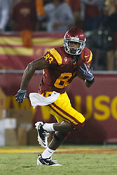 September 11, 2010; Los Angeles, CA, USA;  Southern California Trojans wide receiver Ronald Johnson (83) rushes up field on a kick return against the Virginia Cavaliers during the third quarter at the Los Angeles Memorial Coliseum. USC defeated Virginia 17-14.