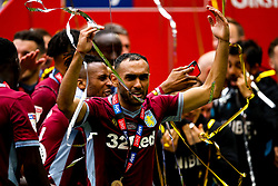 Ahmed Elmohamady of Aston Villa celebrates winning promotion to the Premier League after beating Derby County in the Sky Bet Championship Playoff Final - Mandatory by-line: Robbie Stephenson/JMP - 27/05/2019 - FOOTBALL - Wembley Stadium - London, England - Aston Villa v Derby County - Sky Bet Championship Play-off Final