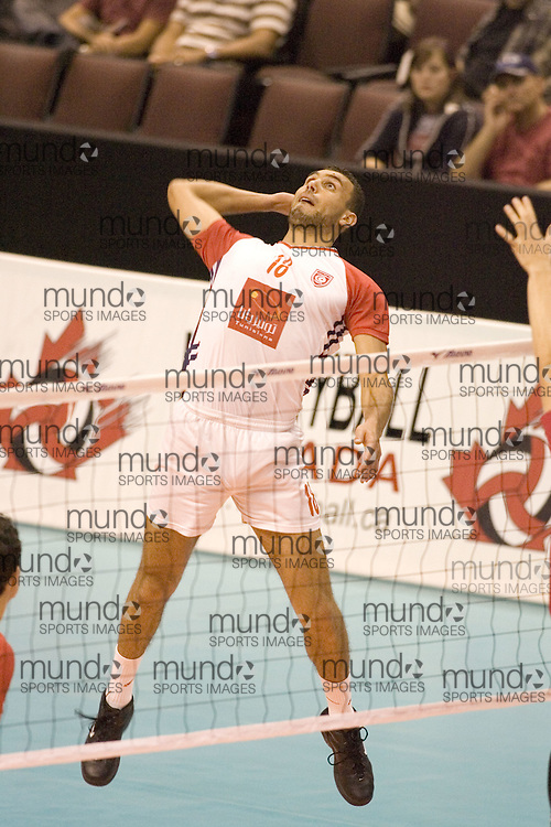 Hosni Karamosly of Tunisia defeating Canada Two three games to none in the 2006 Anton Furlani Volleyball Cup, held in Ottawa, Canada. .Anton Furlani Cup.Copyright Sean Burges / Mundo Sport Images, 2006