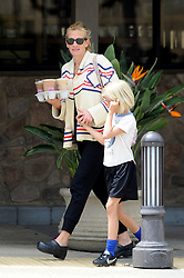 EXCLUSIVE: Julia Roberts picks up the morning coffees in Malibu. The actress was seen carrying 4 iced coffees as she did a morning shop with her two sons in Malibu. Julia wrapped up with her thick jumper and sunglasses as she held hands and balanced the coffees. 27 Jun 2014 Pictured: Julia Roberts, Hazel Moder. Photo credit: MEGA TheMegaAgency.com +1 888 505 6342