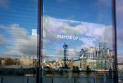 With the City skyline in the distance, the Mayor of London's message appears to Londoners from a screen inside City Hall on the Southbank, on 14th December 2017, in London, England.