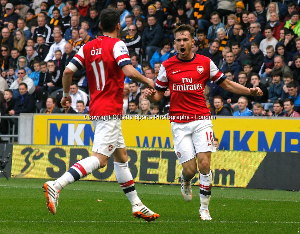 20 April 2014 Premier League Football Hull City v Arsenal -<br /> Aaron Ramsey celebrates the opening Arsenal goal with Mesut Ozil.<br /> Photo: Mark Leech