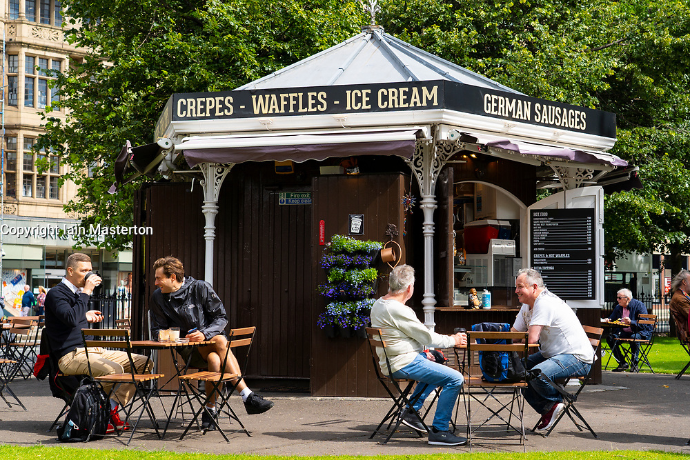 Edinburgh, Scotland, UK. 28 July, 2020. Business and tourism slowly returning to the shops and streets of Edinburgh city centre. The public returning to enjoy cafe inside East Princes Street Gardens which have recently reopened after landscaping and drainage improvement works. Iain Masterton/Alamy Live News