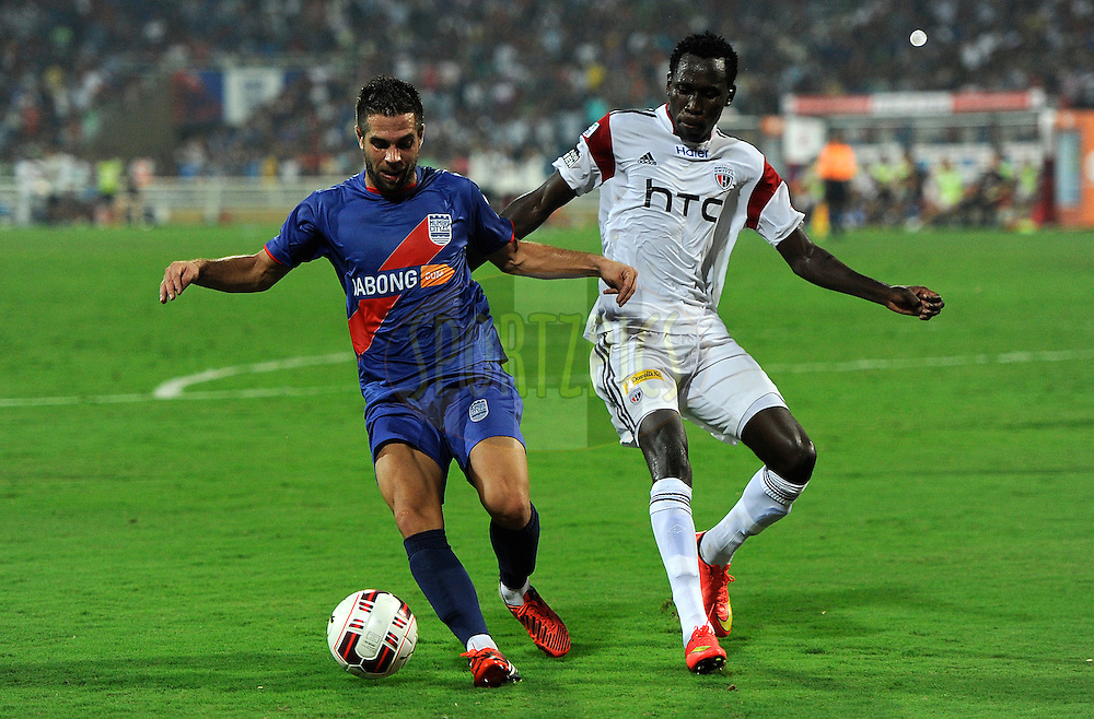 Johan Letzelter of Mumbai City FC and Kondwani Mtonga of NorthEast United FC fight for the ball during match 11 of the Hero Indian Super League between Mumbai City FC and North East United FC City held at the D.Y. Patil Stadium, Navi Mumbai, India on the 24th October 2014.<br /> <br /> Photo by:  Pal Pillai/ ISL/ SPORTZPICS