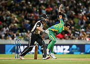 Pakistan's Umar Gul bowls as Black Cap's Kane Williamson watches on from the non strikers end during the second T20 match of the ANZ International T20 series - New Zealand Black Caps v Pakistan played at Seddon Park, Hamilton, New Zealand on Sunday 17 January 2016. Copyright Photo:  Bruce Lim / www.photosport.nz