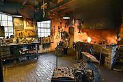 Nederland, Arnhem, 21-8-2014Nederlands Openluchtmuseum. De Zaanse Schans, oud Hollandse bouwkunst. Smid,smidse,smederij,smeden,vuur,werkplaats,ijzer,ambacht,vak,Foto: Flip Franssen/Hollandse Hoogte
