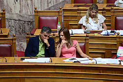 September 6, 2017 - Athens, Attiki, Greece - Euclid Tsakalotos Minister of Economics (left) and Efi Achitsoglou Minister for Labor, Social Security and Social Solidarity (right) during the discussion in Hellenic Parliament of the draft concerning public pension arrangements, the protection of workers and other provisions. (Credit Image: © Dimitrios Karvountzis/Pacific Press via ZUMA Wire)