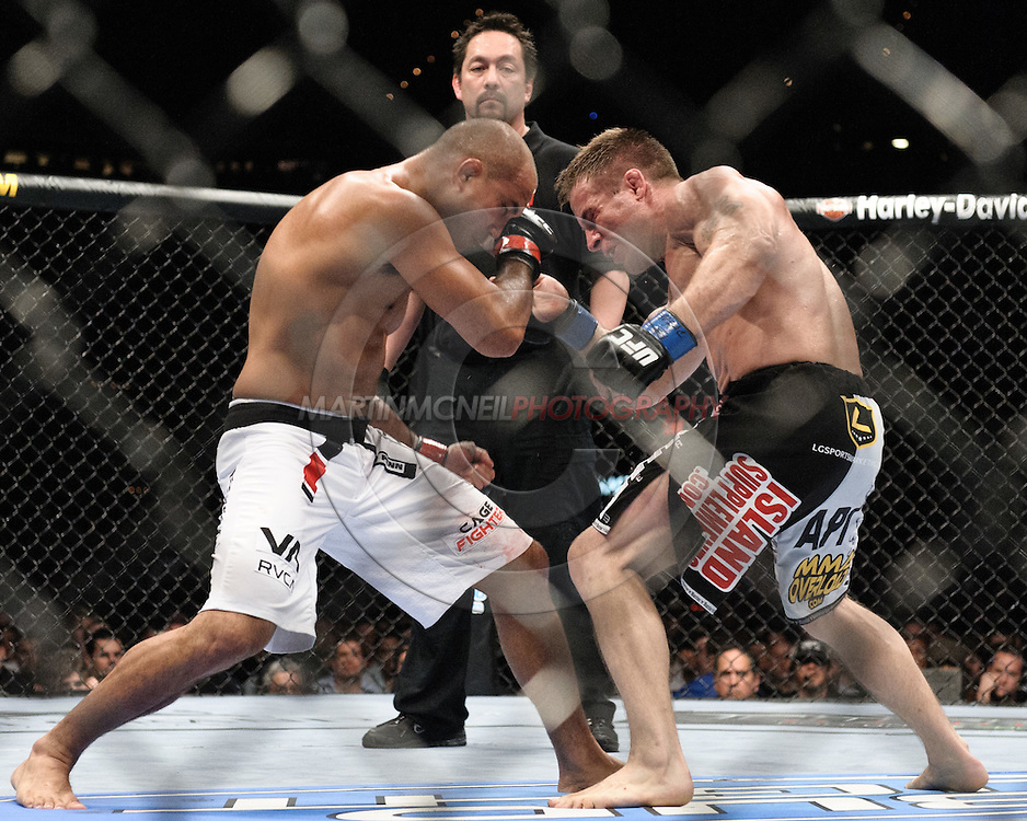 """LAS VEGAS, NEVADA, MAY 24, 2008: BJ Penn (left) and Sean Sherk trade blows during """"UFC 84: Ill Will"""" inside the MGM Grand Garden Arena in Las Vegas"""