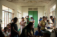 CLIENT: PROJECT HOPE<br /> <br /> Patients line up in the outpatient ward at the Tapaz District Hospital in the province of Capiz on Panay Island, Philippines.  Almost a month after Typhoon Yolanda (aka Typhoon Haiyan), the hospital roof still leaks in many places.