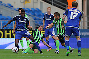 Barry Fuller (Captain)of AFC Wimbledon, Sammy Ameobi during the Capital One Cup match between Cardiff City and AFC Wimbledon at the Cardiff City Stadium, Cardiff, Wales on 11 August 2015. Photo by Stuart Butcher.