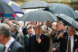 © Licensed to London News Pictures. 04/11/2015. London, UK. Veterans sheltering from the rain underneath an umbrellas during the service. A service to mark the opening of the Filed of Remembrance at Westminster Abbey, attended by Prince Philip, Duke of Edinburgh and Prince Harry.  The Field of remembrance is a memorial garden to commemorate British and Commonwealth military and civilian servicemen and women in the two World Wars and later conflicts. Photo credit: Ben Cawthra/LNP