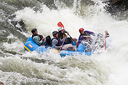 Unidentified whitewater rafters power their raft through the rapids at Sweets Falls on the Gauley River during American Whitewater's Gauley Fest weekend. The upper Gauley, located in the Gauley River National Recreation Area is considered one of premier whitewater rivers in the country.