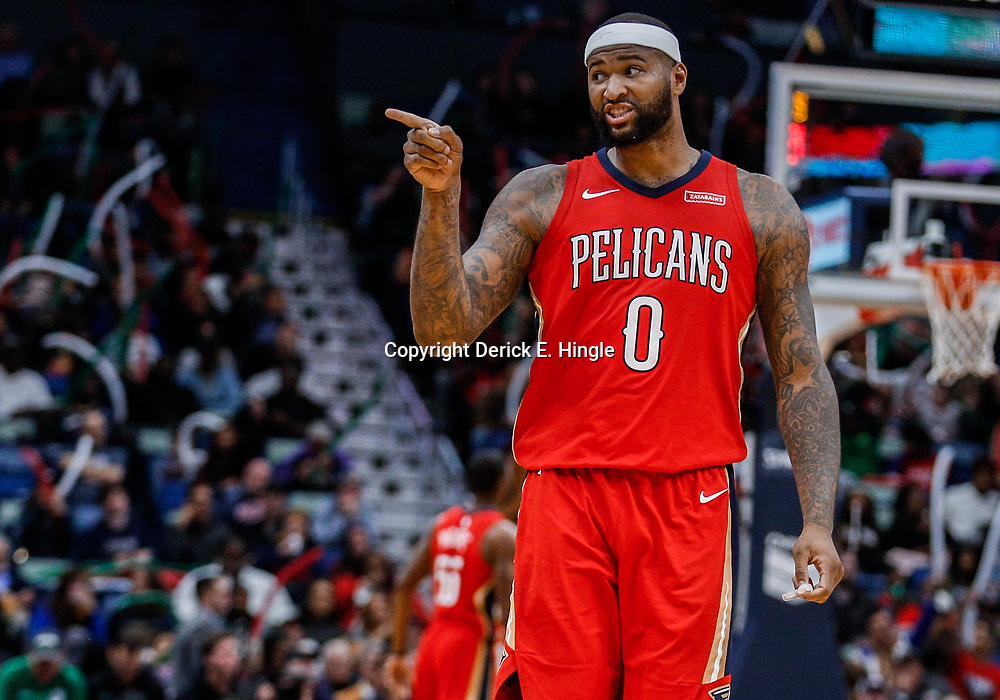 Dec 13, 2017; New Orleans, LA, USA; New Orleans Pelicans center DeMarcus Cousins (0) gestures to a fan courtside during the third quarter against the Milwaukee Bucks at the Smoothie King Center. The Pelicans defeated the Bucks 115-108. Mandatory Credit: Derick E. Hingle-USA TODAY Sports