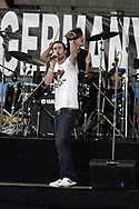 """PHILADELPHIA - JULY 02:  Singer Adam Levine and drummer Ryan Dusick of Maroon 5 perform on stage at """"Live 8 Philadelphia"""" at the Philadelphia Museum of Art July 2, 2005 in Philadelphia, Pennsylvania. The free concert is one of ten simultaneous international gigs including London, Berlin, Rome, Paris, Barrie, Tokyo, Cornwall, Moscow and Johannesburg. The concerts precede the G8 summit (July 6-8) to raising awareness for MAKEpovertyHISTORY.  (Photo by William Thomas Cain/Getty Images)"""