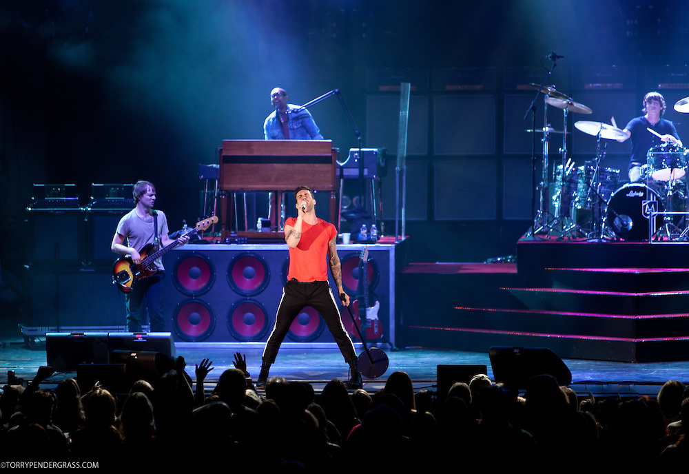"Adam Levine, PJ Morton (keys), Matt Flynn (R), Michael Madden (L)) of Maroon 5 perform at the Hollywood Bowl in support of ""Hands All Over"" on July 25, 2011 in Los Angeles, California."
