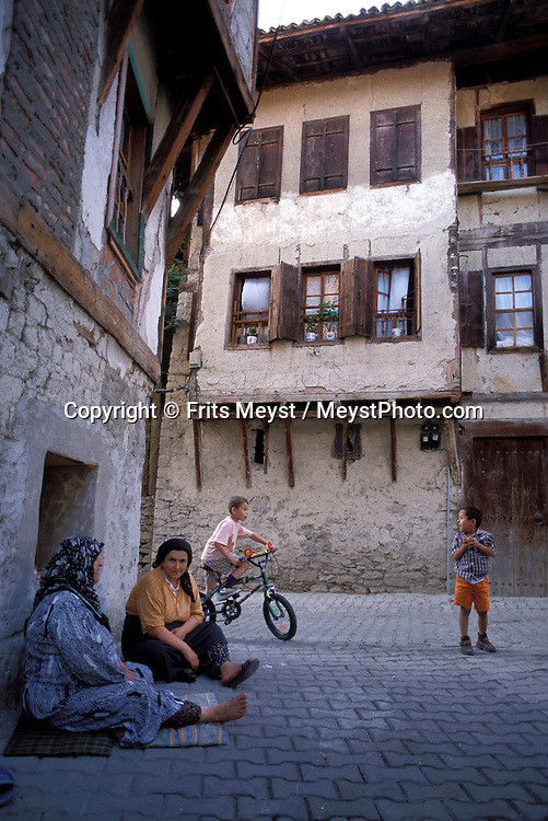 SAFRANBOLU, TURKEY AUGUST 2003. Women sit in the shade of their traditional houses. The city of Safranbolu positioned in the forests on the Black Sea coast is one of the world heritage sites of the UNESCO. Apart from its Ottoman era wood and mudbrick houses it is also known for its 'Lokum' or Turkish delight. A delicate sweets with flavours from nuts to rose petals. Photo by Frits Meyst/Adventure4ever.com