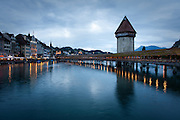 The Kapellbrücke crosses the Reuss River, as taken during dusk, Lucerne, Switzerland.