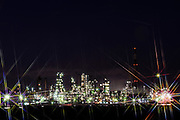 Photo shows an oil refinery lit up at night in Yokohama, Japan.