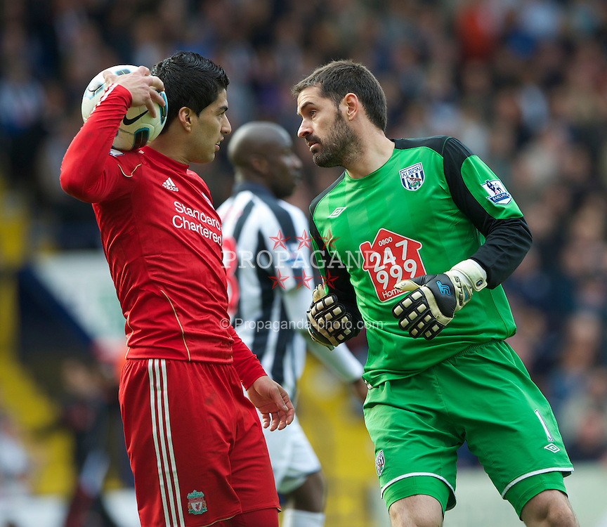 WEST BROMWICH, ENGLAND - Saturday, April 2, 2011: West Bromwich Albion's goalkeeper Scott Carson and Liverpool's Luis Alberto Suarez Diaz during the Premiership match at The Hawthorns. (Photo by Dave Kendall/Propaganda)