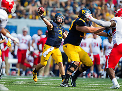 Sep 10, 2016; Morgantown, WV, USA; West Virginia Mountaineers quarterback Skyler Howard (3) passes the ball during the second quarter against the Youngstown State Penguins at Milan Puskar Stadium. Mandatory Credit: Ben Queen-USA TODAY Sports
