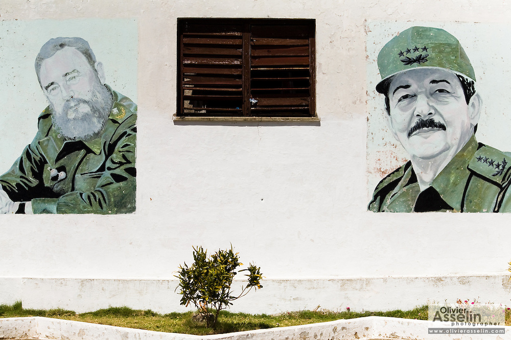 Wall paintings depicting Fidel (left) and Raul Castro in Baracoa, Cuba on Monday July 14, 2008.