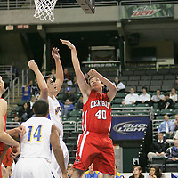 Colt forward Thomas Schmittdiel (40) throws a jump shot in a crowd of Viking defenders.