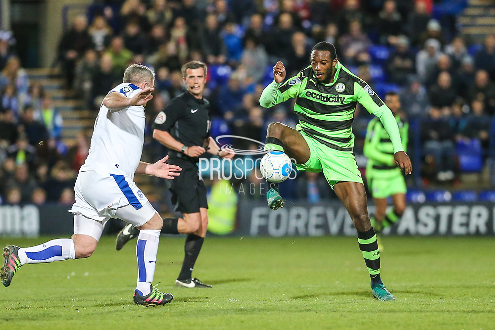 Forest Green Rovers Shamir Mullings(18) controls the ball under pressure from Tranmere Rovers Steve McNulty(5) during the Vanarama National League match between Tranmere Rovers and Forest Green Rovers at Prenton Park, Birkenhead, England on 11 April 2017. Photo by Shane Healey.