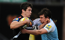 Exeter Chiefs Ian Whitten is tackled by Newcastle Falcons Adam Powell  - Photo mandatory by-line: Harry Trump/JMP - Mobile: 07966 386802 - 14/02/15 - SPORT - Rugby - Aviva Premiership - Sandy Park, Exeter, England - Exeter Chiefs v Newcastle Falcons