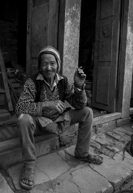 Citizen of Bhaktapur, Nepal takes a smoke break